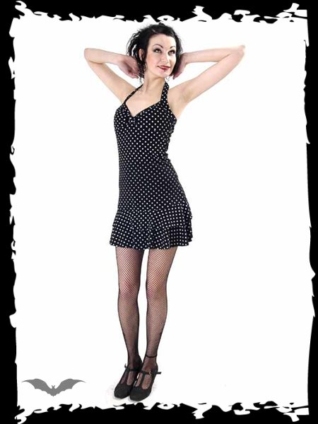 Black sun dress with white polka dots